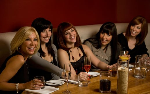 five Smiling women wearing wigs