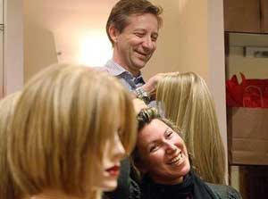 Michael Suba, owner of Continental Hair, shows a wig during a party he hosted to discuss women's options for thinning hair. (Oct. 2, 2008) Photograph by : Steve Russell, Toronto Star