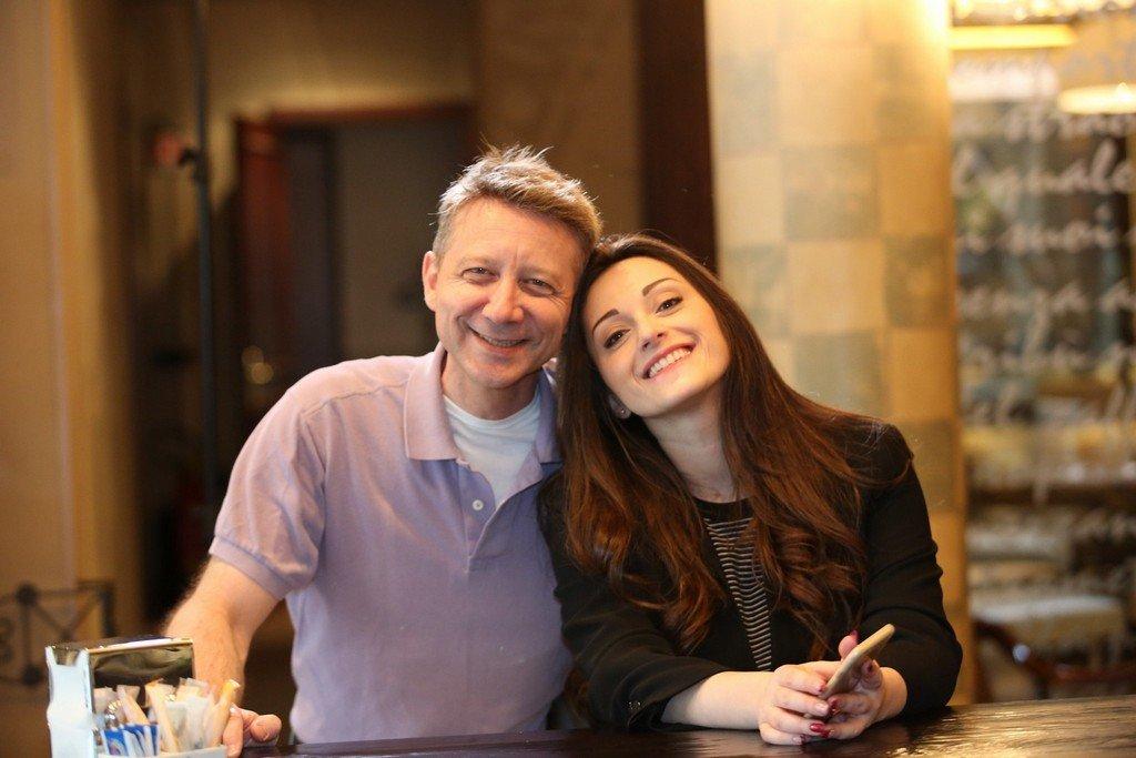 Michael Suba and Michaela smiling at bar